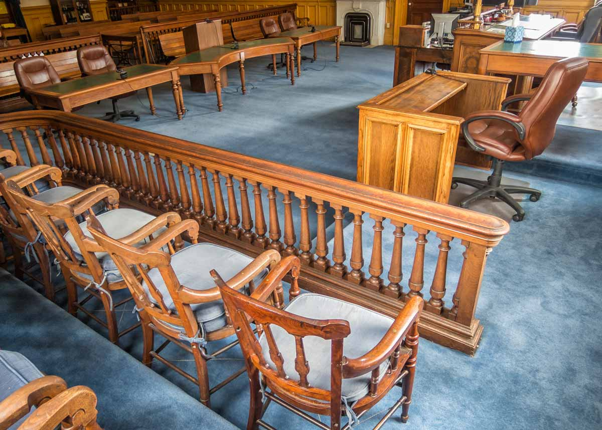 court room with jury seats and wooden decor