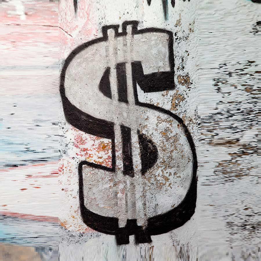 a graffiti dollar sign on an old torn wall